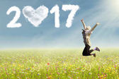 depositphotos_130430018-stock-photo-woman-jumping-on-flowers-field